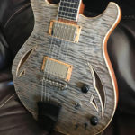 frost grey, grain highlighted quartersawn quilted maple
