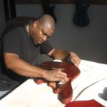 Teaching Carlton Armstrong how to stain and sand his guitar was not easy :)